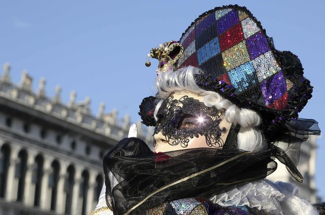 A masked reveller poses at Saint Mark's square during Carnival in Venice, February 8, 2015. The carnival runs until February 17. (Photo by Stefano Rellandini/Reuters)