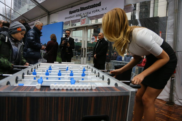 Sports Illustrated swimsuit model Hailey Clauson plays foosball against a young fan at SwimCity festival in New York City on Monday February 9, 2015. (Photo by Gordon Donovan/Yahoo News)