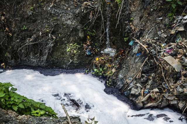 Factory waste drains into a tributary of the Citarum river on August 27, 2018 outside Bandung, Java, Indonesia. (Photo by Ed Wray/Getty Images)
