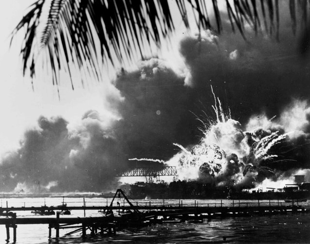 The forward magazine of the destroyer USS Shaw explodes during the second Japanese attack wave on Pearl Harbor, Hawaii, U.S. December 7, 1941. (Photo by Reuters/U.S. Naval History and Heritage Command)