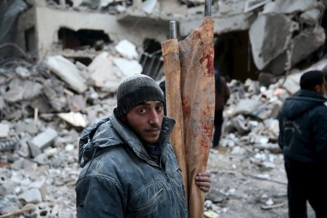 A man carries a blood stained stretcher in a site hit by what activists said were airstrikes carried out by the Russian air force in the town of Douma, eastern Ghouta in Damascus, Syria January 10, 2016. (Photo by Bassam Khabieh/Reuters)