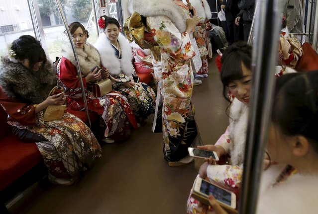 Japanese women wearing kimonos ride on a train after their Coming of Age Day celebration ceremony at an amusement park in Tokyo January 11, 2016. (Photo by Yuya Shino/Reuters)