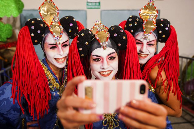 Participants pose for a selfie backstage before a drag queen competition during carnival festivities in Las Palmas on the Spanish Canary Island of Gran Canaria February 20, 2015. (Photo by Borja Suarez/Reuters)