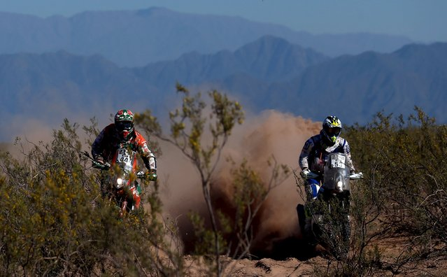 Mario Patrao (L) of Portugal rides his KTM next to Jacopo Cerutti of Italy on his Husqvarna during the ninth stage of the Dakar Rally 2016 near Belen, Argentina, January 12, 2016. (Photo by Marcos Brindicci/Reuters)