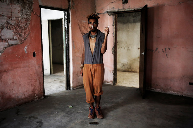 Teflon, 19, who is among members of lesbian, gay, bisexual and transgender (LGBT) community, that have been invited to live in a building that the roofless movement has occupied, poses for a portrait, in downtown Sao Paulo, Brazil, November 26, 2016. (Photo by Nacho Doce/Reuters)