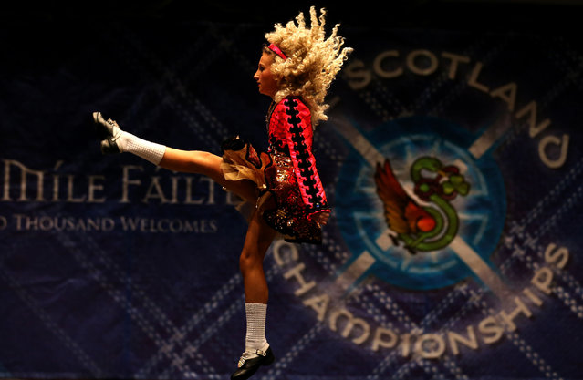 Shannon Love from the Scanlon dance school in Birmingham performs in one of the heats in the All Scotland Championships in Irish Dancing being held at the Royal Concert Hall in Glasgow. (Photo by Andrew Milligan/PA Wire)