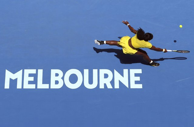 Serena Williams of the U.S. reaches for a shot during her first round match against Italy's Camila Giorgi at the Australian Open tennis tournament at Melbourne Park, Australia, January 18, 2016. (Photo by Jason O'Brien/Reuters)