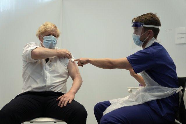 British Prime Minister Boris Johnson after receiving his second jab of the AstraZeneca coronavirus vaccine, at the Francis Crick Institute in London, Thursday, June 3, 2021. (Photo by Matt Dunham/AP Photo/Pool)