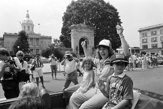 NASA's choice for the first in Space, Christa McAuliffe, rides in front of the New Hampshire with her daughter Caroline and son Scott. McAuliffe, a social teacher at Concord High School, riding, Saturday, July 21, 1985 at Concord in a Lions Club parade. (Photo by Jim Cole/AP Photo)