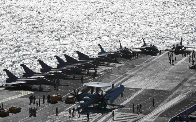 Rafale fighter jets, Super Etendards and a E2C Hawkye (C) are seen aboard France's Charles de Gaulle aircraft carrier that is on mission in the Gulf, January 28, 2016. (Photo by Philippe Wojazer/Reuters)