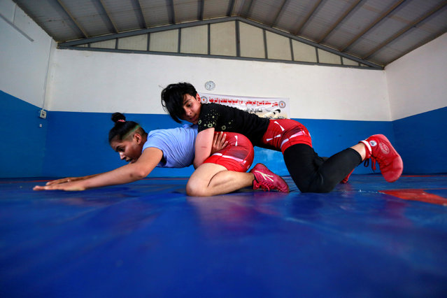 Iraqi women wrestle during practice at the sports club in Diwaniya, Iraq on November 10, 2018. This is the second attempt by the Iraqi Wrestling Federation (IWF) to grow women's wrestling, this time prompted by the threat of a ban by the sport's global body if they didn't. (Photo by Alaa Al-Marjani/Reuters)