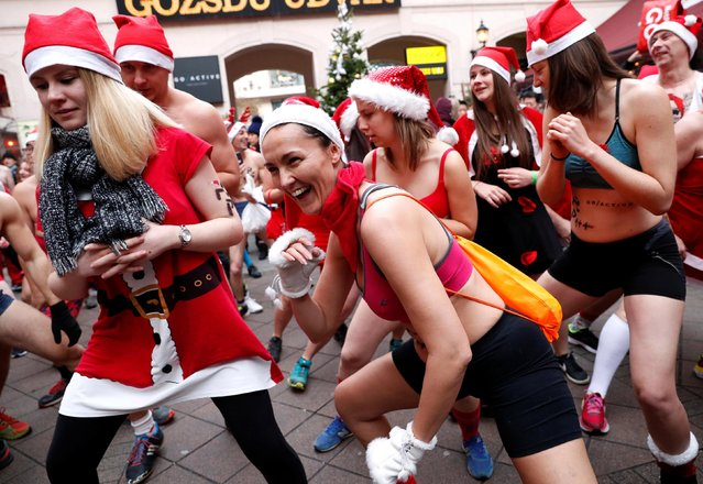 People take part in a half naked Santa run in downtown Budapest, Hungary, December 9, 2018. (Photo by Bernadett Szabo/Reuters)