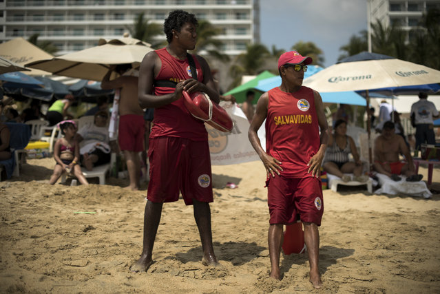 Lifeguards keep a watchful eye on April 2, 2015 in Acapulco, Mexico. (Photo by Jonathan Levinson/The Washington Post)