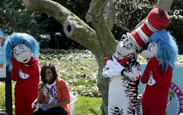 """U.S. first lady Michelle Obama (C) reads """"Oh, the Things You Can Do That Are Good For You"""", a Tish Rabe adaptation of a Dr. Seuss book, to children visiting the White House during the annual Easter Egg Roll in Washington April 6, 2015. (Photo by Gary Cameron/Reuters)"""