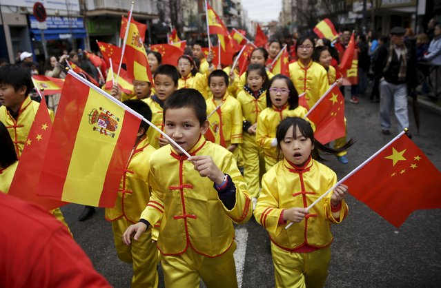 Children perform during a parade to celebrate the Chinese Lunar New Year, which welcomes the Year of the Monkey, in Madrid, Spain, February 13, 2016. (Photo by Andrea Comas/Reuters)