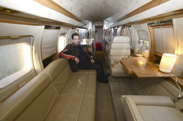 Owner Toby Rhys-Davies sits inside his luxury Jetstar private jet, built in the seventies and retaining most of the original features which is now being used as a holiday let in Redberth, Pembrokeshire, Wales, January 11, 2017. (Photo by Rebecca Naden/Reuters)