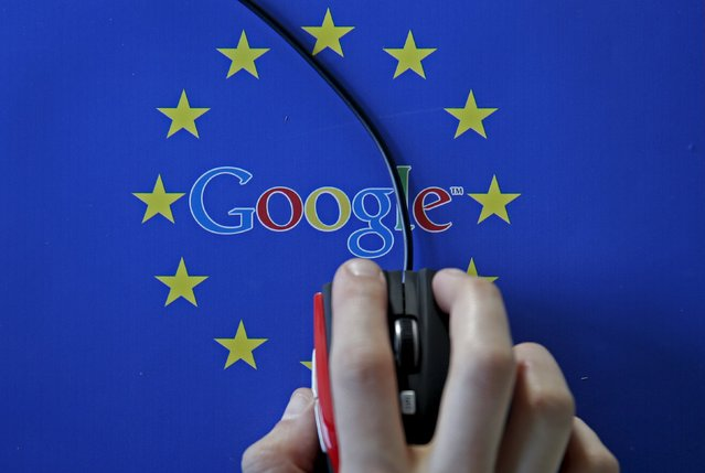 A woman hovers a mouse over the Google and European Union logos in Sarajevo, in this April 15, 2015 photo illustration. The European Union accused Google Inc on Wednesday of cheating competitors by distorting Internet search results in favour of its Google Shopping service and also launched an antitrust probe into its Android mobile operating system. (Photo by Dado Ruvic/Reuters)