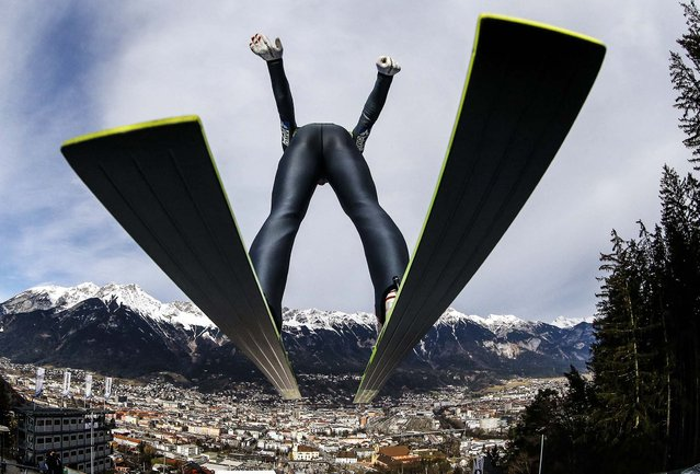 Austria's Gregor Schlierenzauer takes off from the ski jump during the first practice session of the third jumping of the four-hills tournament in Innsbruck, January 3, 2014. The prestigious four-hills tournament will end in Bischofshofen on January 6. (Photo by Kai Pfaffenbach/Reuters)