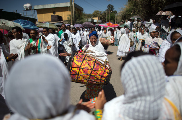A worshipper bangs a drum during a procession to mark the annual Timkat epiphany celebration on January 18, 2017 in Gondar, Ethiopia. (Photo by Carl Court/Getty Images)