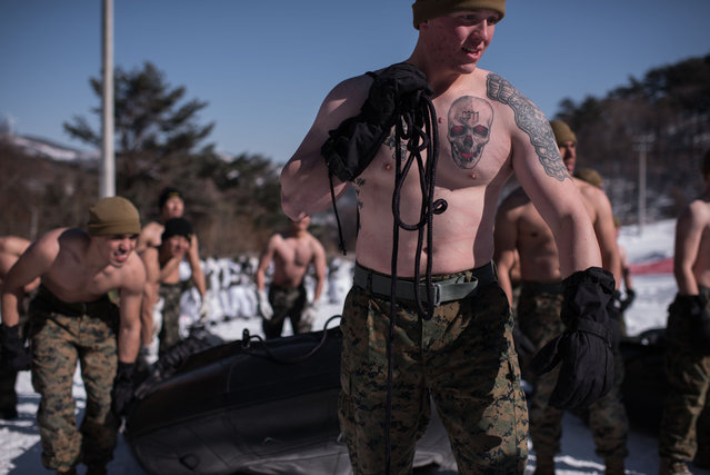 South Korean and US soldiers prepare to perform a demonstation for the media during a joint annual winter exercise in Pyeongchang, some 180 kilometers east of Seoul, on January 24, 2017. The Korean peninsula is the world's last Cold War frontier as Stalinist North Korea and pro-Western South Korea have been technically at war since the 1950-53 conflict. (Photo by Ed Jones/AFP Photo)