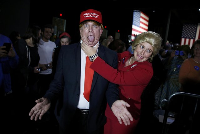 Supporters of Democratic U.S. presidential candidate Hillary Clinton, who came to her rally in costume as Republican presidential candidate Donald Trump (L) and as Mrs. Clinton (R), clown around as they attend her Super Tuesday night party in Miami, Florida, March 1, 2016. (Photo by Jonathan Ernst/Reuters)