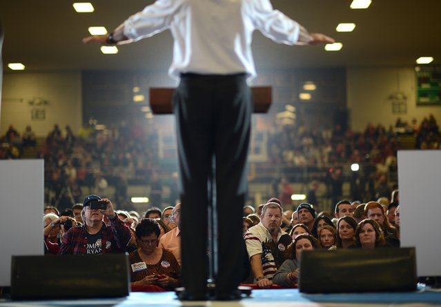 Supporters listen to US Republican Presidential candidate Mitt Romney during a rally at the Veterans Memorial Coliseum in Marion, Ohio, October 28, 2012. (Photo by Emmanuel Dunand/AFP Photo)