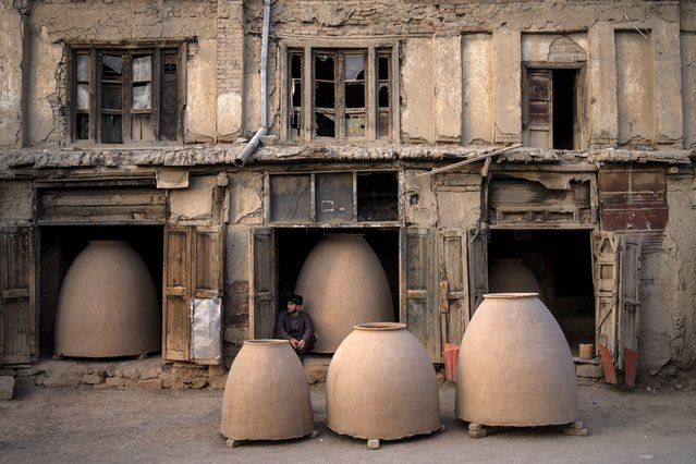 An Afghan potter sits among tandoor ovens in Kabul, Afghanistan, Monday, September 20, 2021. (Photo by Bernat Armangue/AP Photo)