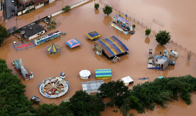 A flooded amusement park is seen in the city of Franco da Rocha, in the north of Sao Paulo state, Brazil, March 11, 2016. (Photo by Paulo Whitaker/Reuters)