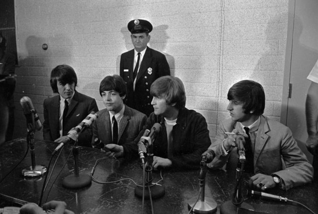 The Beatles sit before a battery of michrophones in Dallas, September 18, 1964 as they hold a news conference before their concert. From left, are: George Harrison, Paul McCartney, John Lennon, and Ringo Starr. (Photo by AP Photo/STF)