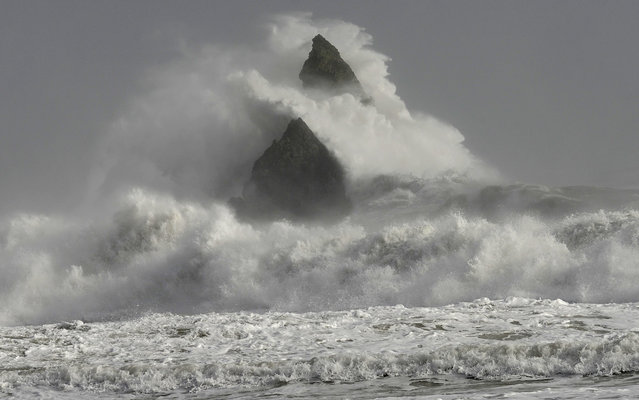 Large waves crash over Church Rock as hurricane force winds reach the coastline at Broad Haven, Pembrokeshire, Wales, February 12, 2014. (Photo by Rebecca Naden/Reuters)