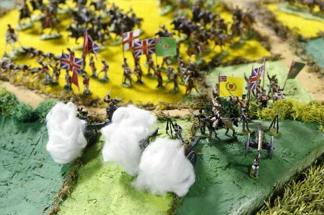 Miniature cannons on the British side of the Battle of Waterloo are seen firing, with cotton wool being used to depict smoke, on a 40-square-metre miniature model of the June 18, 1815 battlefield, in Diest, Belgium, in this picture taken on April 29, 2015. (Photo by Francois Lenoir/Reuters)