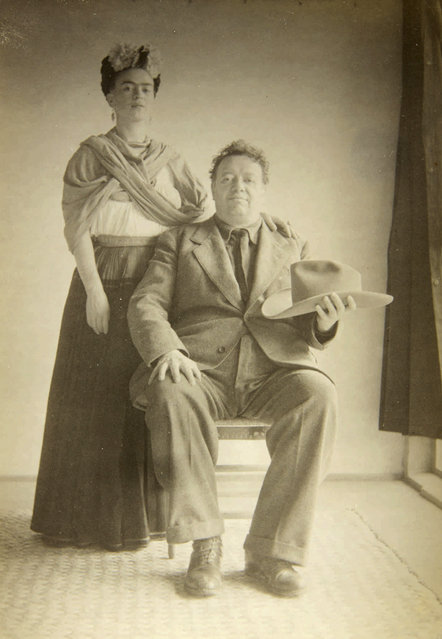 In this 1940 photo provided by Sotheby's, artists Frida Kahlo and Diego Rivera pose for a portrait. The image is part of a collection of photographs by Nicholas Muray up for auction on Friday, April 5, 2019. (Photo by Nickolas Muray via Sothebys via AP Photo)
