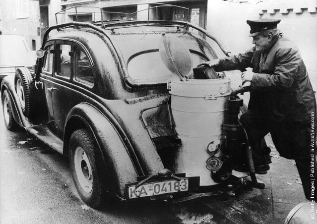 An Adler Diplomat car, built in Germany in 1936, with its carburettor that uses wood instead of petrol, fitted during World War II