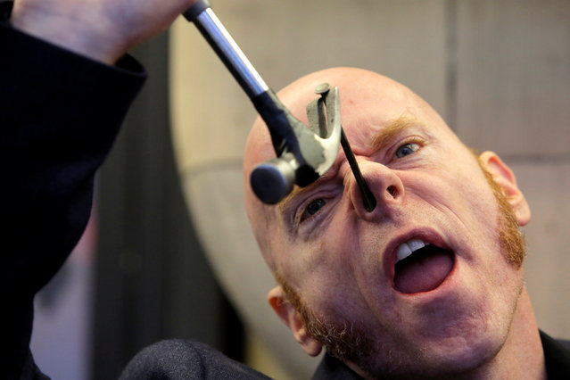 Performer Albert Cadabra removes a nail hammered into his nose at Ripley's Believe It or Not! Times Square Odditorium during celebrations for World Sword Swallower's Day in Manhattan, New York, U.S., February 25, 2017. (Photo by Andrew Kelly/Reuters)