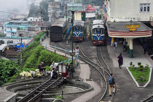 Darjeeling Himalayan Railway trains which run on a 2 foot gauge railway and is a UNESCO World Heritage Site, are seen at a station in Darjeeling, India, June 25, 2019. (Photo by Ranita Roy/Reuters)