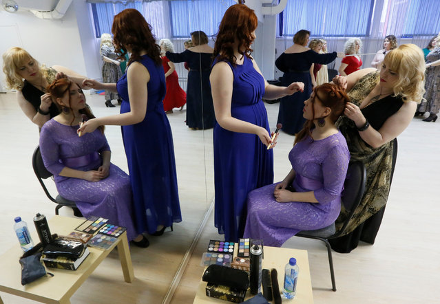 Models of the SibPlus Models agency and participants of the Miss Doughnut beauty competition prepare before a rehearsal in Krasnoyarsk, Siberia, Russia March 4, 2017. (Photo by Ilya Naymushin/Reuters)