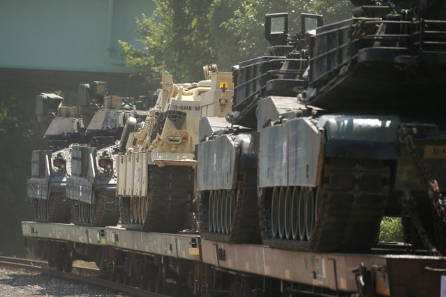 M1 Abrams tanks and other armored vehicles sit atop flat cars in a rail yard after U.S. President Donald Trump said tanks and other military hardware would be part of Fourth of July displays of military prowess in Washington, U.S., July 2, 2019. (Photo by Leah Millis/Reuters)