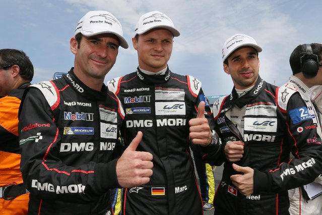 Porsche No18 drivers, from left to right, French Romain Dumas, German Marc Lieb and Swiss Neel Jani, thumb up before the start of the 83rd 24-hour Le Mans endurance race, in Le Mans, western France, Saturday, June 13, 2015. (AP Photo/David Vincent)