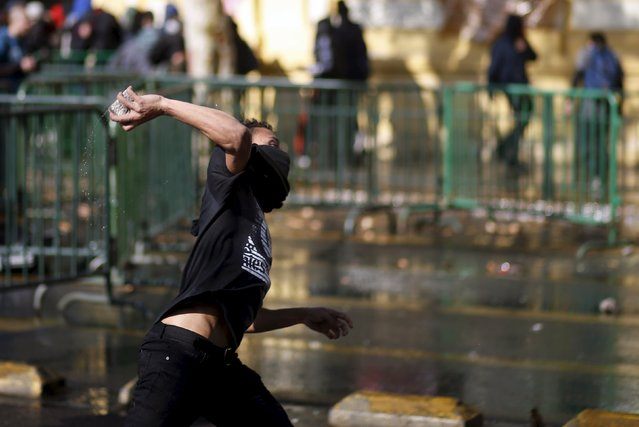 A protester hurls a rock at the police during a protest to demand changes in the Chilean education system in Santiago, Chile June 25, 2015. (Photo by Marcos Brindicci/Reuters)