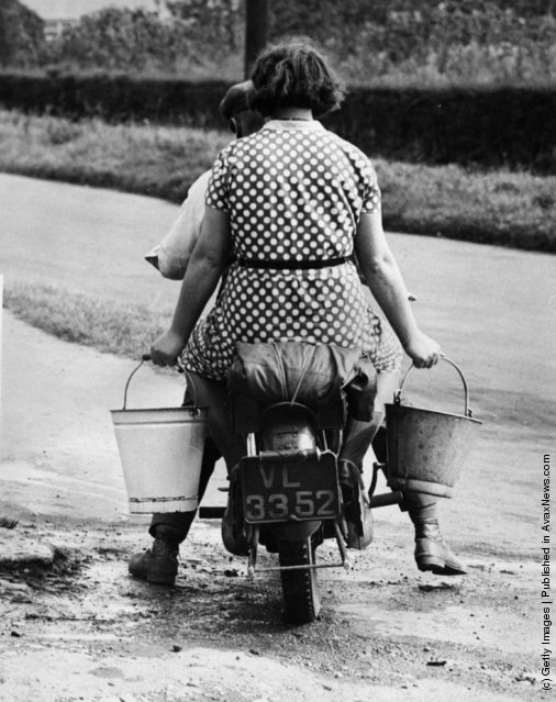 1933: Residents of Faldingworth travelling on a motorbike to collect water five miles away from a stream in Dunholme