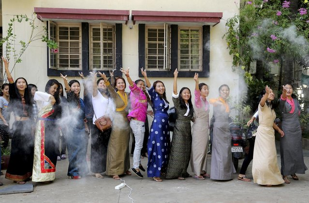 Exile Tibetan students throw white flour powder in the air during the 80th birthday celebrations of their spiritual leader the Dalai Lama, in Bangalore, India, Sunday, June 28, 2015. The Dalai Lama who was born on July 6 according to the Gregorian calendar is scheduled to be giving talks in the United States on his birthday. (Photo by Aijaz Rahi/AP Photo)