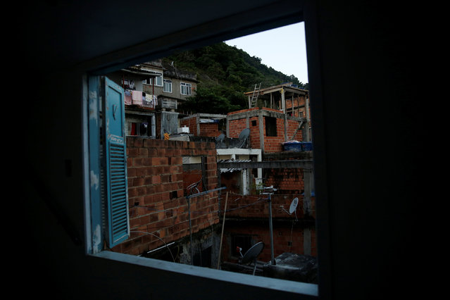 Houses are seen through a window of Tiki hostel in Cantagalo favela, in Rio de Janeiro, Brazil, April 15, 2016. (Photo by Pilar Olivares/Reuters)