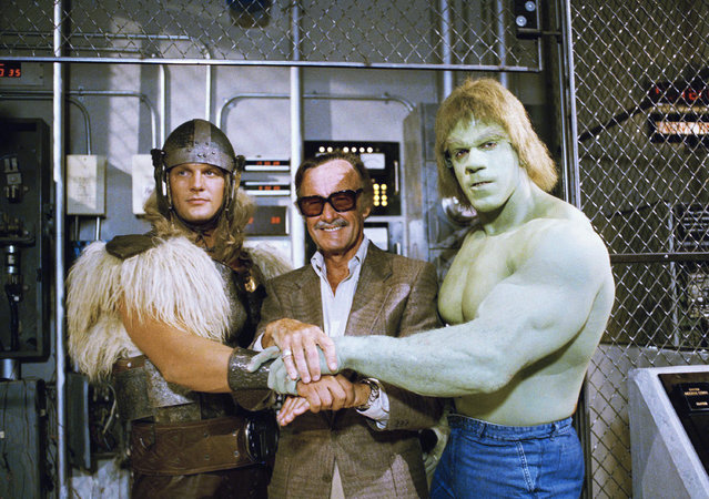 "In this May 9, 1988, file photo, comics impresario Stan Lee, center, poses with Lou Ferrigno, right, and Eric Kramer who portray ""The Incredible Hulk"" and Thor, respectively, in a special movie for NBC, ""The Incredible Hulk Returns"", May 9, 1988, Los Angeles, Calif. Comic book genius Lee, the architect of the contemporary comic book, has died. He was 95. The creative dynamo who revolutionized the comics by introducing human frailties in superheroes such as Spider-Man, The Fantastic Four and The Incredible Hulk, was declared dead Monday, November 12, 2018, at Cedars-Sinai Medical Center in Los Angeles, according to Kirk Schenck, an attorney for Lee's daughter, J.C. Lee. (Photo by Nick Ut/AP Photo)"