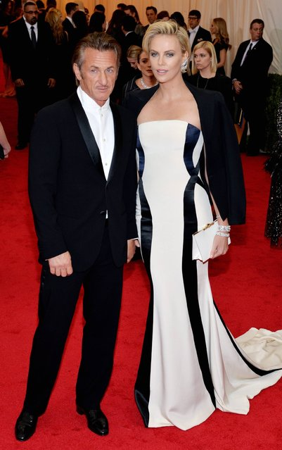 "Sean Penn and Charlize Theron attend the ""Charles James: Beyond Fashion"" Costume Institute Gala at the Metropolitan Museum of Art on May 5, 2014 in New York City. (Photo by Kevin Mazur/WireImage)"