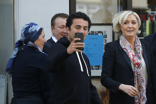 French far-right leader and candidate for the 2017 presidential election Marine Le Pen, right, poses for a photo after getting a haircut in Paris, Monday, April 24, 2017. France's political mainstream, shut out of the presidency by an angry electorate, united on Monday to call on voters to back centrist Emmanuel Macron and reject Marine Le Pen's populist nationalism. (Photo by Michel Euler/AP Photo)