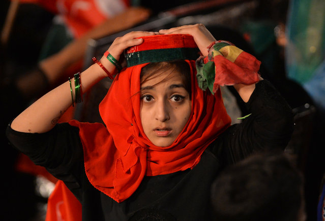 A young supporter of Pakistani cricketer-turned-opposition leader and head of the Pakistan Tehreek-i-Insaf (PTI) Imran Khan attends an anti-governement rally in Islamabad on April 28, 2017. Pakistan's top court ordered the prime minister be investigated for corruption on April 20, in a highly anticipated decision that granted Nawaz Sharif a temporary reprieve as judges said there was insufficient evidence to oust him from power. Sharif and his children had been accused of graft in an ongoing case that had threatened to topple the prime minister and captivated Pakistan after the Panama Papers leak last year linked the family to offshore business. (Photo by Aamir Qureshi/AFP Photo)