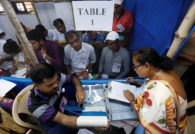 Election officials count votes in the West Bengal Assembly elections, at a counting centre in Kolkata, India May 19, 2016. (Photo by Rupak De Chowdhuri/Reuters)