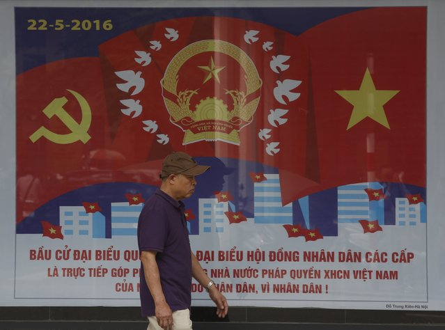 A man walks past a poster on the 14th National Assembly election on a street in Hanoi, Vietnam, April 20, 2016. (Photo by Reuters/Kham)