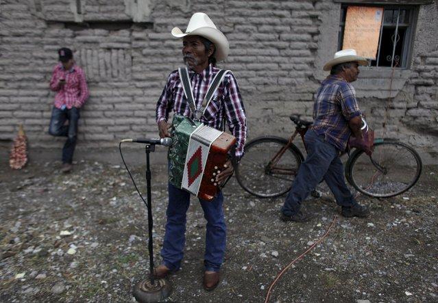 A musician plays the accordion in the neighborhood of La Esperanza, on the outskirts of Monterrey July 19, 2015. Picture taken July 19, 2015. (Photo by Daniel Becerril/Reuters)
