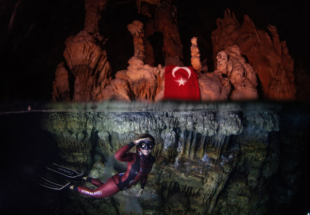 Turkish world record-holder free-diver Sahika Ercumen makes a formal salute during her training before attempting to break the 90-meter women's cave diving (without fins) world record at the Gilindire Cave in Aydincik, a town in southern Turkey's Mersin on October 27, 2019. (Photo by Sebnem Coskun/Anadolu Agency via Getty Images)